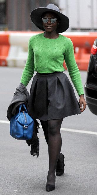 skirt sweater fall outfits pumps green sweater black skirt hat lupita nyong'o