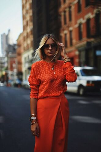 orange blouse blogger outfit idea office outfits fine knit jumper asymmetrical skirt stacked jewelry stacked bracelets oversized sunglasses fall colors theclosetheroes sunglasses