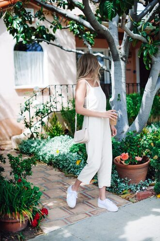 hustle and halcyon blogger jumpsuit shoes bag jewels shoulder bag white jumpsuit sneakers spring outfits