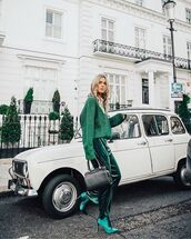 pants,velvet,heel boots,handbag,black bag,green sweater