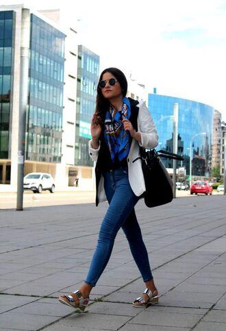 shoes sandals flat sandals silver sandals silver low heel sandals jeans blue jeans scarf printed scarf blazer white blazer bag black bag sunglasses