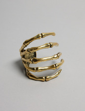 jewels,ring,gold,bones,hand,skull