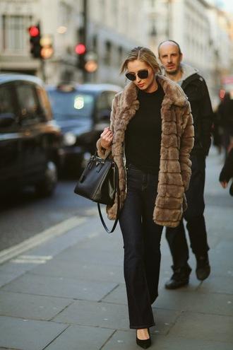 fashionism blogger flare jeans fur coat