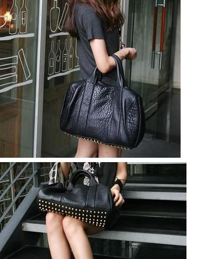 Studded black leather duffle bag