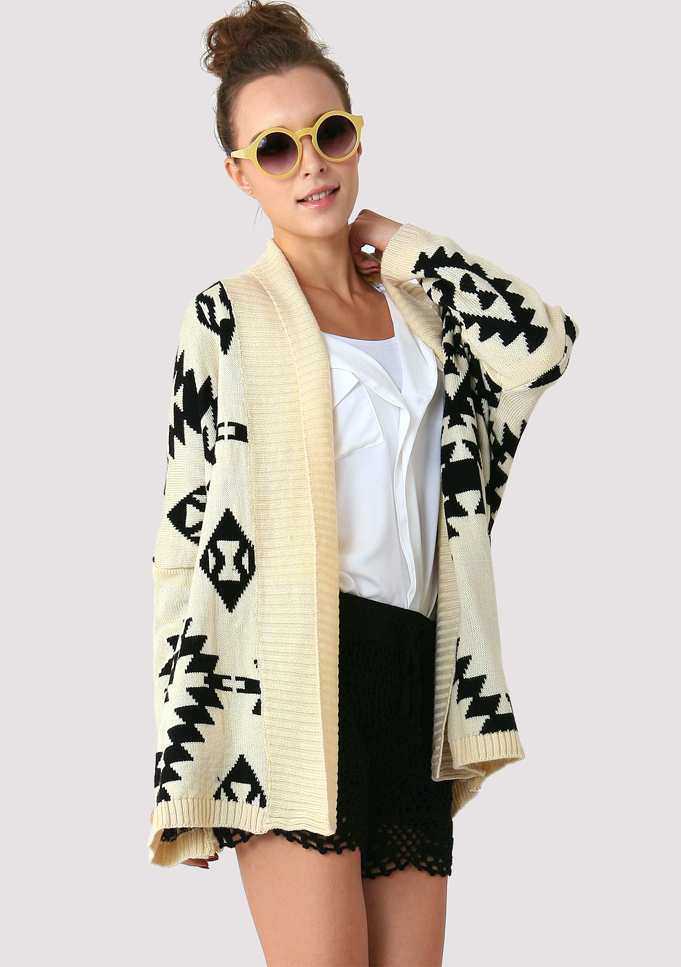 Open front sweaters in black and white triangular designs illustrated on top make warm layering pieces. Wrap yourself in earthen colors in luxuriously fringed knitted pieces. Or, try a multicolored asymmetrical sweater and indulge yourself in a frenzy of mixed lines and alternating repeated patterns in vibrant shades of red, blue, orange.
