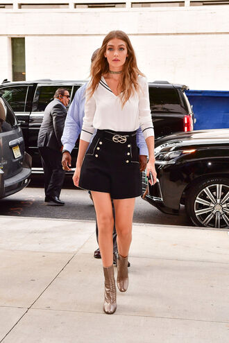 skirt boots blouse gigi hadid model off-duty tommy hilfiger streetstyle ny fashion week 2016 mini skirt fall outfits fall sweater choker necklace shorts