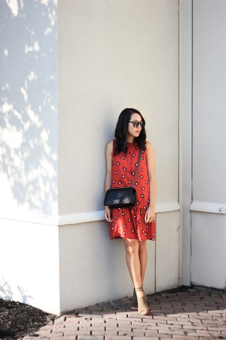 refined couture blogger dress shoes sunglasses bag red dress printed dress shoulder bag chanel chanel bag crossbody bag sleeveless dress summer dress black sunglasses sandals nude sandals sandal heels high heel sandals summer outfits red mini dress