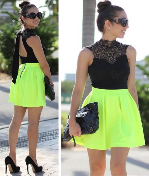 black heels blouse skater skirt purse sunglasses