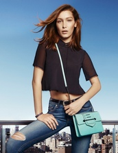 Bella Hadid Crop Top,crop tops,black crop top,denim,jeans,ripped jeans,bag,blue bag,bella hadid,celebrity,model,black blouse,skinny jeans