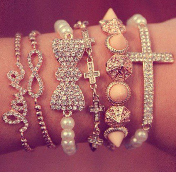 jewels cross love infinty bow pearl crosses diamonds infinity pyramid studs sparkle bracelets bows jewelry pink glitter girl jewelery infinity bracelet bow bracelet gold gold bracelet gold stones bracelets home accessory accessories friendship bracelets