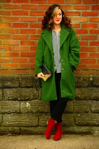 rachelthehat blogger coat jeans green coat clutch bag ankle boots red boots striped shirt black pants spring outfits