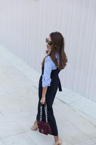 jumpsuit tumblr blue jumpsuit cropped jumpsuit bag chain bag shirt blue shirt sunglasses