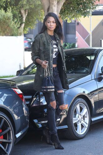 jacket streetstyle chanel iman model off-duty ankle boots ripped jeans top shoes