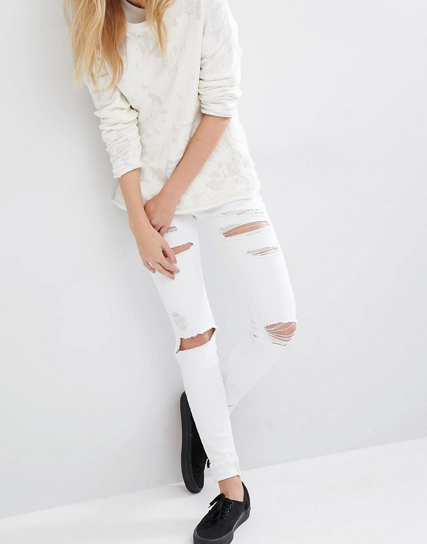 Dr Denim Regina Mid Rise Skinny Destroyed Jeans at asos.com
