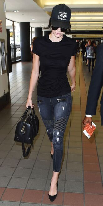 hat black cap baseball cap cap blue jeans jeans t-shirt black t-shirt bag black bag airport fashion sunglasses pointed toe pumps pumps black pumps kendall jenner celebrity
