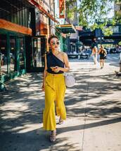 pants,yellow pants,wide-leg pants,one shoulder,sunglasses,bag