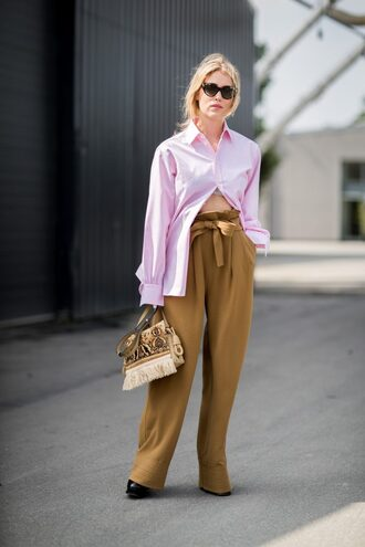 shirt pink shirt pants khaki khaki pants high waisted pants bag printed bag sunglasses streetstyle copenhagen fashion week wide leg beige pants beige pants wide-leg pants