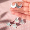 Pastel holographic stud earrings in crescent moon star and heart shapes · kawaii kave · online store powered by storenvy