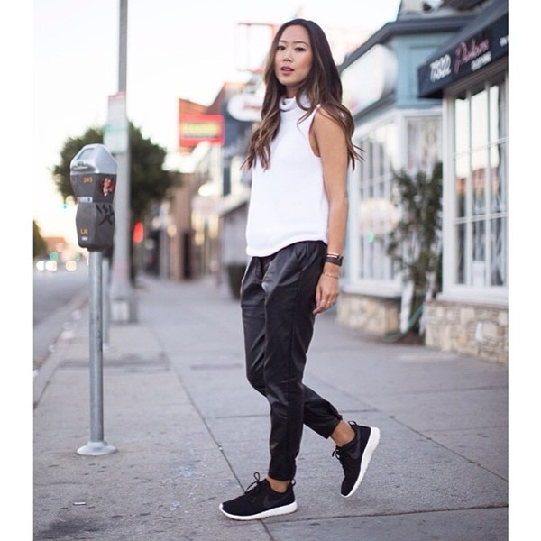 pants leather pants black leather white top black pants black dark loose loose pants leather black and white nike nike running shoes shoes songofstyle