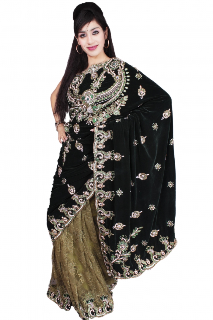 Sarees : this combination of dark and light green color velvet saree with grand embroidery and handwork design all over the saree is shown.