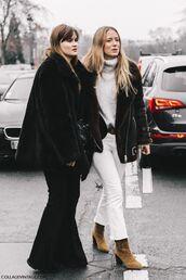 jacket,tumblr,black fur jacket,fur jacket,black jacket,pants,black pants,flare pants,fashion week 2017,fashion week street style,streetstyle,jeans,white jeans,cropped bootcut white jeans,cropped bootcut jeans,boots,brown boots,ankle boots,suede,suede boots,sweater,white sweater,turtleneck sweater,turtleneck,shearling jacket,brown shearling jacket