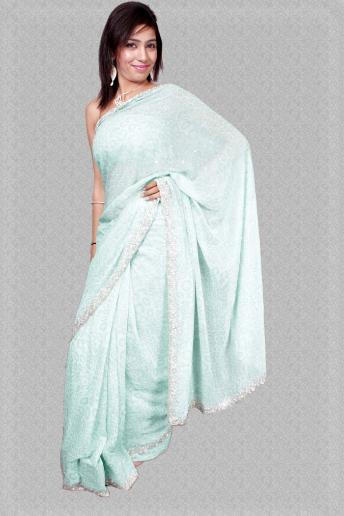 Sarees : designer saree in brasso with silver border and self print all over