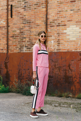 pants pink top copenhagen fashion week streetstyle pink pants track pants matching set top sneakers bag sunglasses