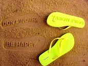 shoes,flip-flops,green,yellow,sandals,dont worry,be happy,neon yellow,beach,impression,impression leaving flip flops,neon,little black dress,don't worry,quote on it,sea,sand,don't worry be happy,message,slippers,mothers day gift idea