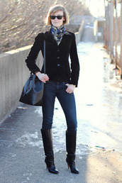 district of chic,blogger,black jacket,bucket bag,printed scarf,black boots,leather boots,scarf,jacket,jewels,jeans,shoes,bag