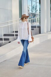 straight a style,blogger,blouse,jeans,bag,hat,shoes,sunglasses,top,flare jeans,blue jeans,white shirt,70s style,bell sleeves,bell sleeve shirt,brown hat,brown bag,shoulder bag,spring outfits,aviator sunglasses,wedges