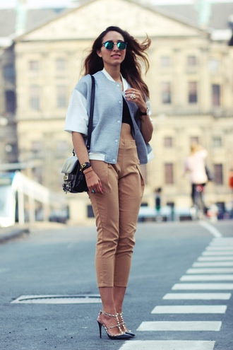preppy fashionist blogger cropped pants high waisted pants baseball jacket mirrored sunglasses spring jacket