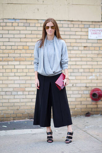 pants light blue blouse red purse black pleated pants black sandals sunglasses blogger
