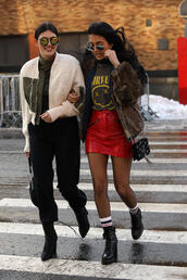 skirt,tumblr,mini skirt,nyfw 2017,fashion week 2017,fashion week,streetstyle,red skirt,vinyl,leather skirt,tights,net tights,fishnet tights,jacket,fur jacket,faux fur jacket,brown jacket,brown,bag,tassel,boots,black boots,ankle boots,high heels boots,socks,t-shirt,logo tee,pants,black pants,top,white jacket,sunglasses,mirrored sunglasses,round sunglasses,00s style