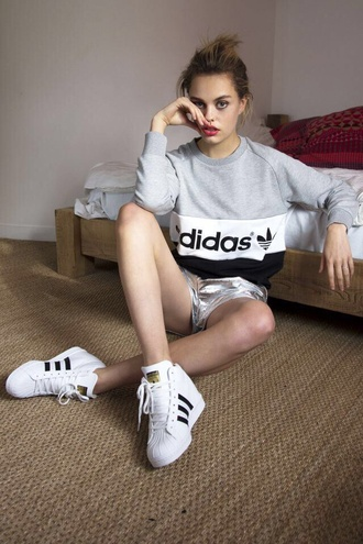 sweater adidas sweater adidas grey hoodie white sneakers blouse shoes adidas shoes sneakers black white shorts sweatshirt adidas wings black dress cool fashion tumblr outfit gym clothes white shoes girl metallic shorts silver shorts metallic grey sweater athleisure high top sneakers sporty