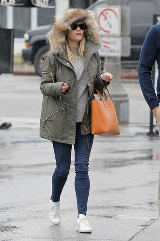 rayban reese witherspoon sneakers sunglasses parka grey sweater leather bag coat