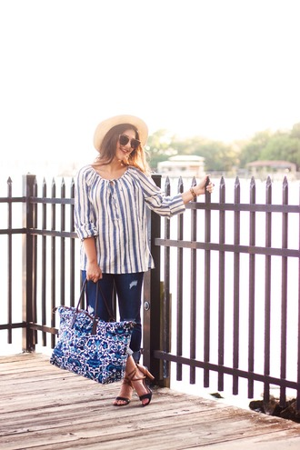 carly maddox blogger sunglasses sandal heels striped shirt sun hat beach bag straw hat