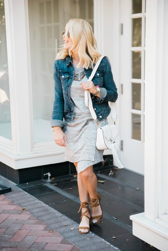 gbo fashion blogger jacket shoes bag jewels white bag tassel shoulder bag denim jacket blue jacket grey dress asymmetrical asymmetrical dress necklace spring outfits sandals lace up sandals brown sandals mid heel sandals