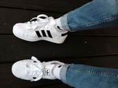 shoes,and,adidas shoes,white,trainers,adidas,adidas superstar 2 shoes,adidas originals,black and white,jeans,superstar,black stripes,blue jeans,adidas superstars,grunge,style