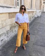 pants,topw,white top,shirt,yellow pants,bag,sunglasses,shoes