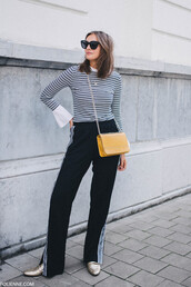 pants,tumblr,track pants,black pants,wide-leg pants,stripes,striped top,bag,yellow,yellow bag,sunglasses,top,shoes