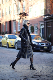 the fashion guitar,blogger,shoes,bag,tights,sunglasses,leather jacket,pleated skirt,black boots,all black everything,jacket,sweater,skirt,black shearling jacket