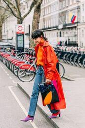 jeans,blue jeans,boots,coat,orange coat,bag,top,orange top,earrings,streetstyle