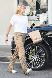 pants,gold,gold pants,hailey baldwin,streetstyle,model off-duty,top,white top