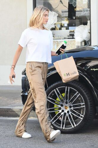 pants gold gold pants hailey baldwin streetstyle model off-duty top white top