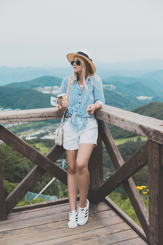 my blonde gal blogger shirt bag shoes white shorts blue top button up shoulder bag straw hat adidas white sneakers romwe mango alice+olivia adidas superstars stripes striped shirt blue shirt adidas shoes