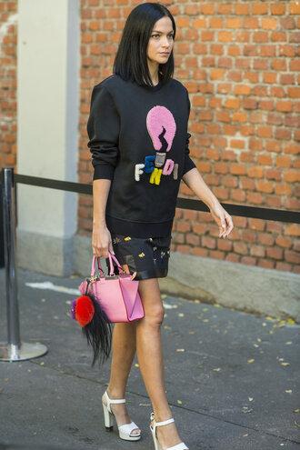 sweater sweatshirt streetstyle fashion week sandals graphic sweatshirt top long sleeves black top fendi bag accessoires fur keychain pink bag bag handbag mini skirt skirt