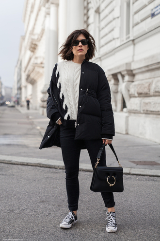 viennawedekind blogger jacket jeans sweater shoes jewels sunglasses bag down jacket black bag sneakers knitted sweater converse