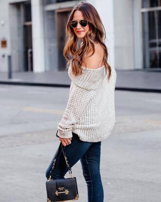 sweater off the shoulder sweater tumblr knit knitted sweater off the shoulder denim jeans blue jeans bag black bag sunglasses