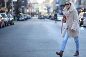 the fashion guitar,blogger,jeans,fuzzy coat,light blue,winter coat,coat,bag,sunglasses,shoes,beige fluffy coat,teddy bear coat