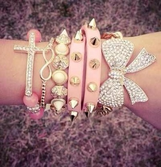 jewels spiked bracelet stacked bracelets pink infinity noeud statches bun chain bracelets jewelry hand jewelry accessories croix spikes spike bow cross gold silver cute